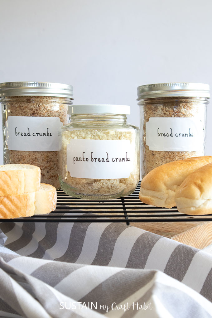 "Three mason jars filled with bread crumbs and labelled with Cricut Joy Smart Label. The labels say ""bread crumbs"" and ""panko bread crumbs."""