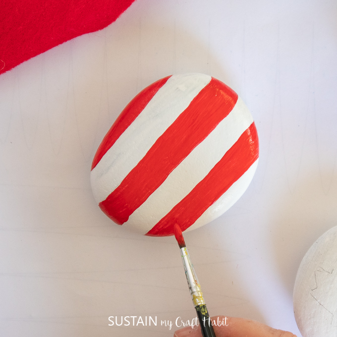 painted evenly sized stripes in red and white