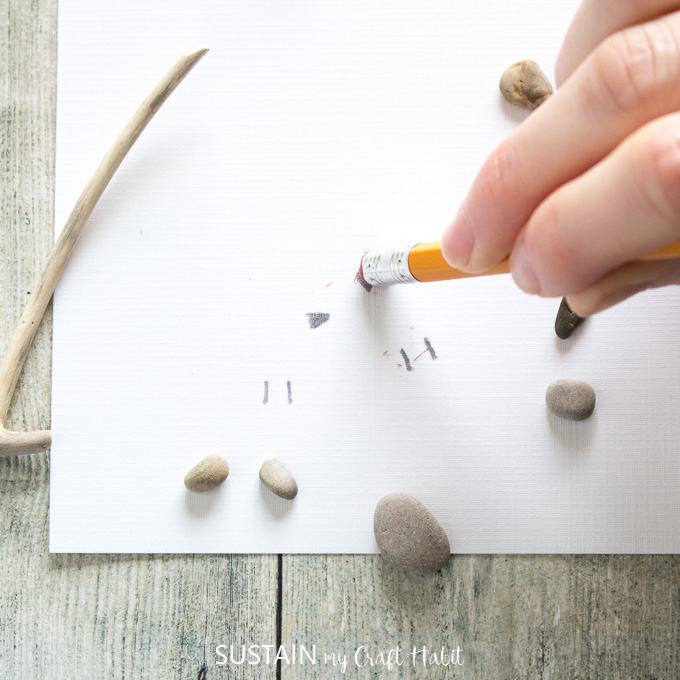 Using the pencil eraser to remove pencil marks.