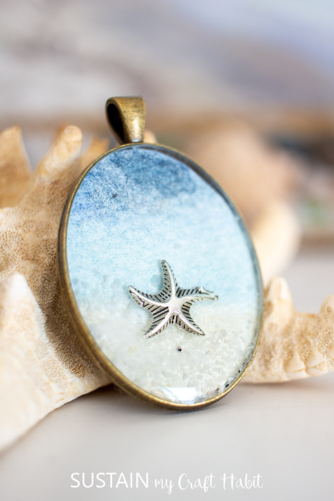 Close up of a starfish inside a seashore resin pendant.