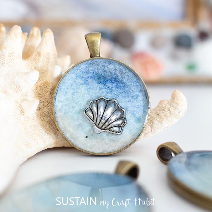 Close up of a seashell inside a seashore resin pendant.