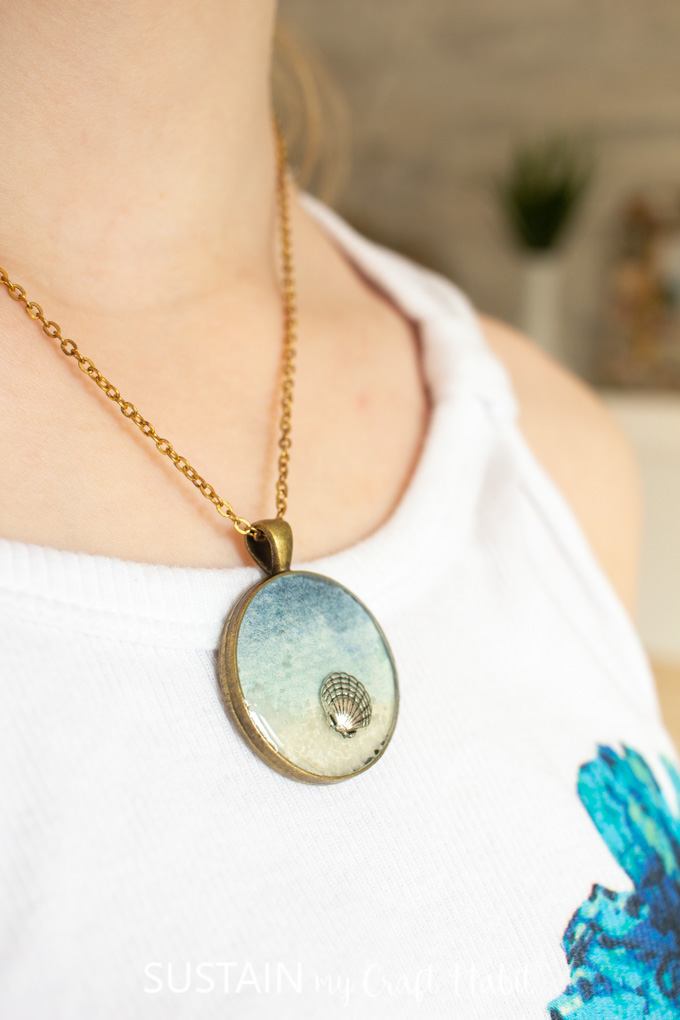 Wearing a seashore resin pendant necklace.