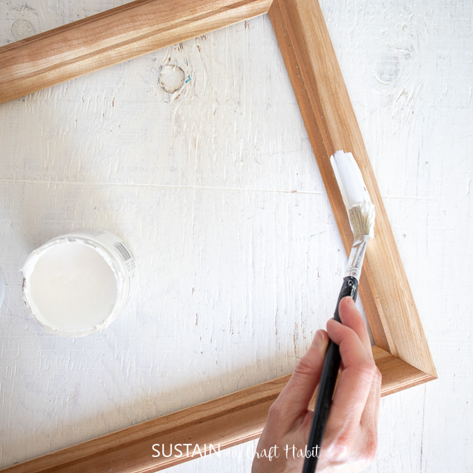 Painting the surface of a picture frame.