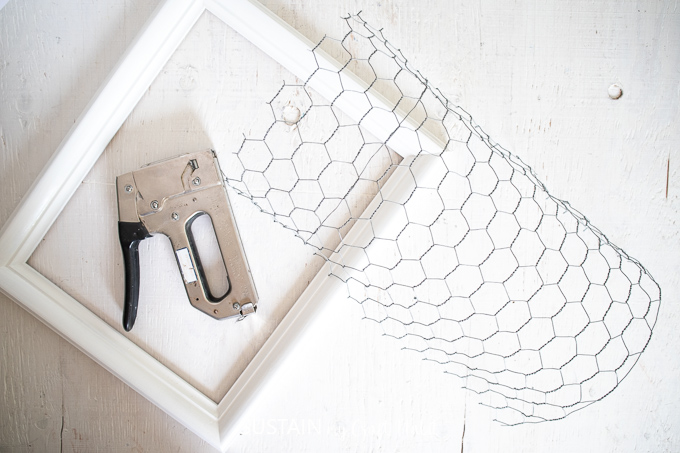 Painted picture frame, cut chicken wire and a staple gun.