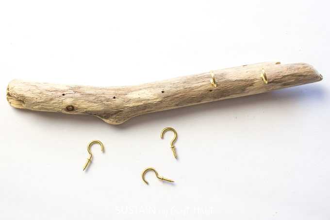 Adding 5 gold hooks to the driftwood.