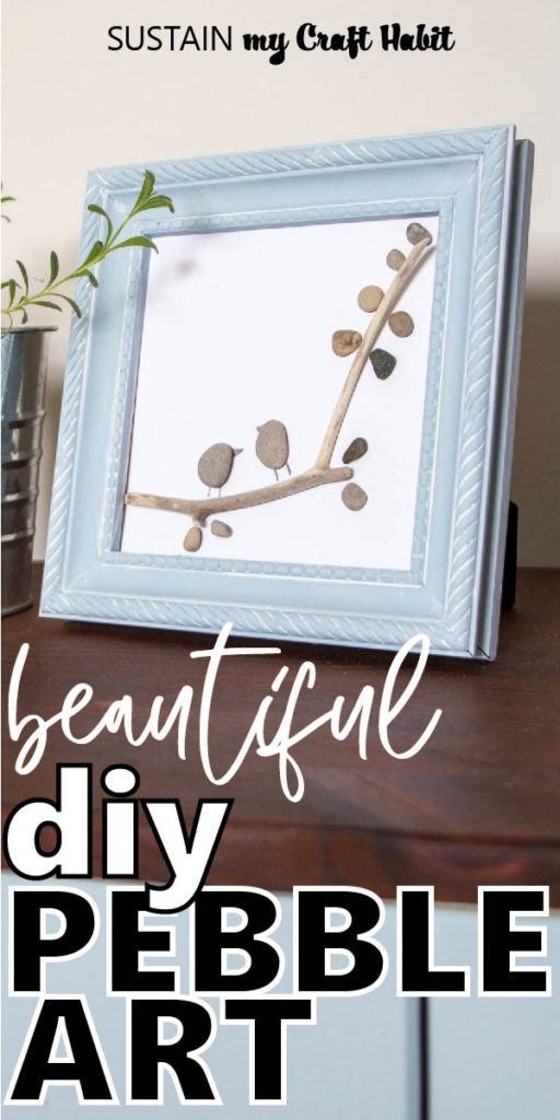"Framed pebble art resembling two birds perched on a tree branch with text overlay ""beautiful diy pebble art."""