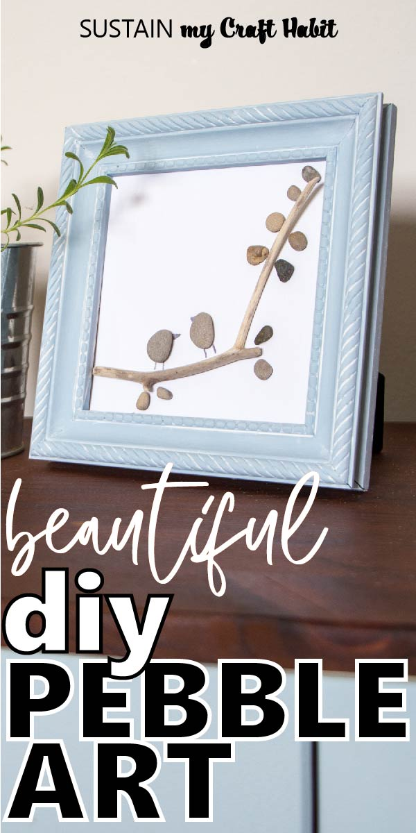 """Framed pebble art resembling two birds perched on a tree branch with text overlay """"beautiful diy pebble art."""""""