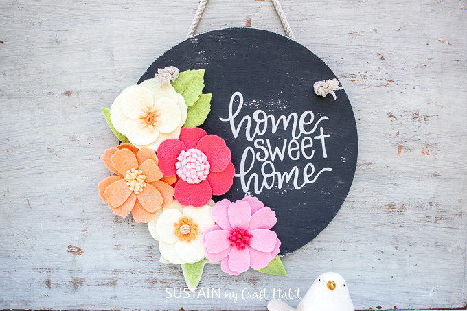 Home sweet home upcycled DIY wood sign with felt flowers.