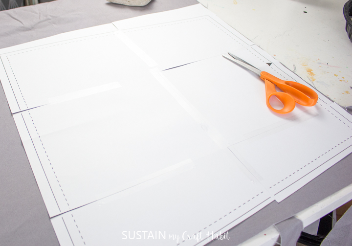 Laying out the pattern pieces onto the fabric to make the dining chair slipcovers.