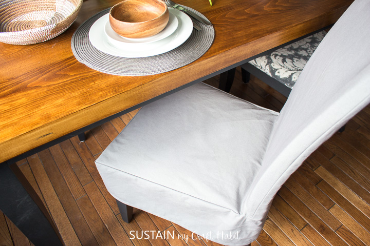 chair with cotton slipcover under a dining room table