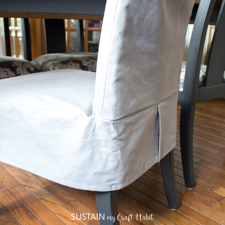 View from behind of a completed dining chair slipcover in place.
