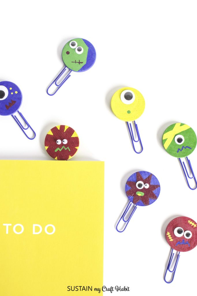 Purple paperclip bookmarks made with colorful monster shapes.