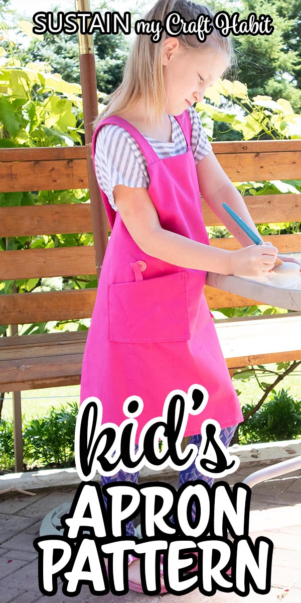"A child wearing a pink apron wihile doing crafts with text overlay ""kid's apron pattern."""