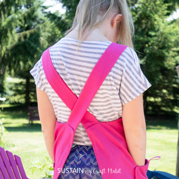 Showing the back of the kid's apron with a cross back style.