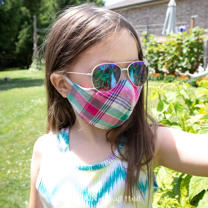 6 year old wearing fitted face mask while outside