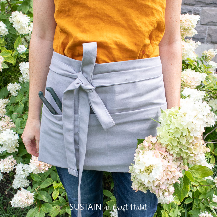 a canvas half apron worn outside in the garden