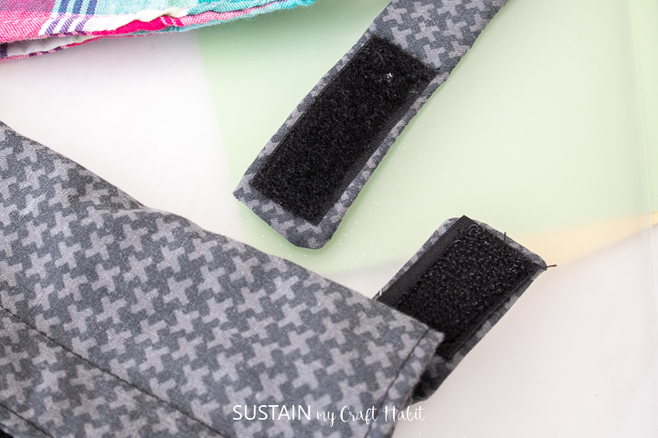 velcro tabs at ends of strap to detach under weight or force for safety