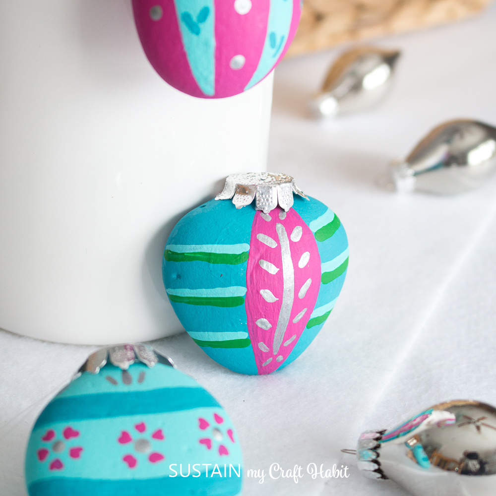 Christmas ornament painted rocks.