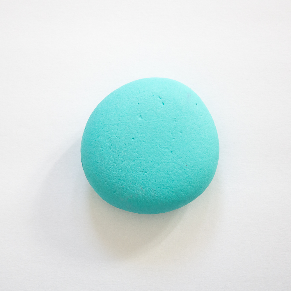 Blue painted round rock