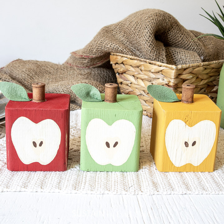 set of 3 DIY wood block apples all lined up in a row