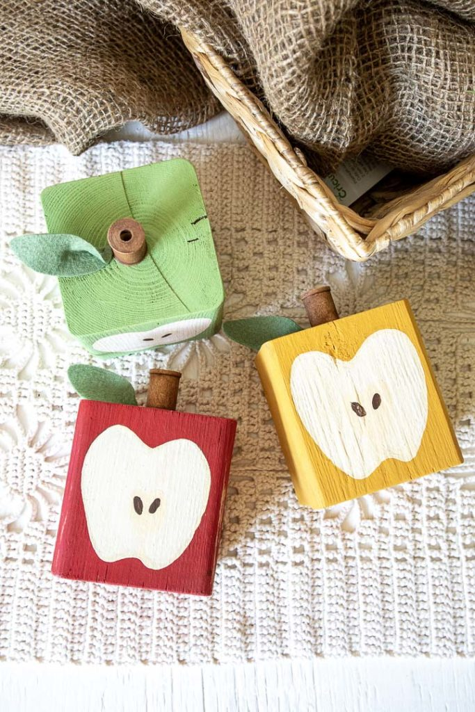 Finished Wood Block Apples painted red, green and yellow.