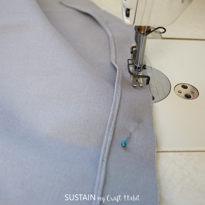 """sewing the pocket facing piece to the apron piece with 1/2"""" seam allowance"""