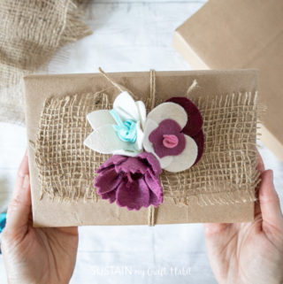 Gluing felt flowers to the burlap.