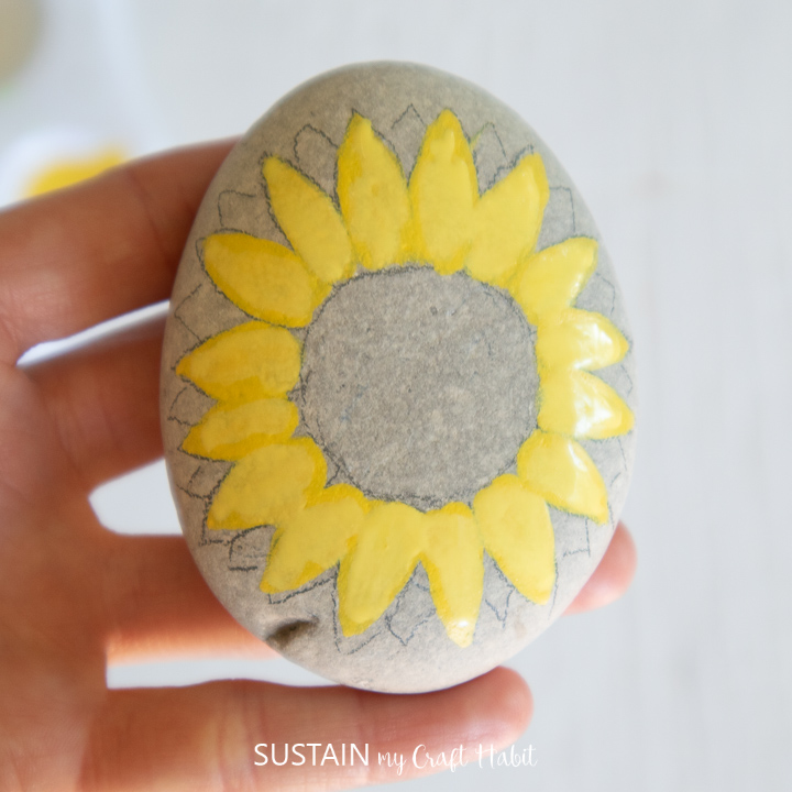 Penciling additional petals around the painted yellow petals.