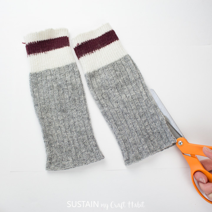 Cutting the length of the wool tube socks.