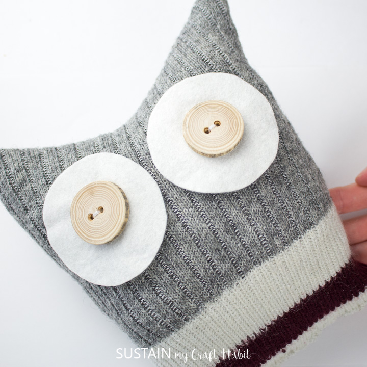 Sewn on felt cirlces and buttons on the sock owl.