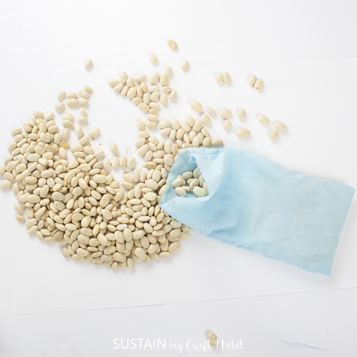 Adding dry beans to the scrap fabric pouch.