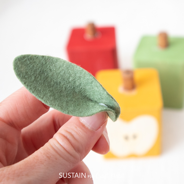 Gluing the edges of the felt leaf together.