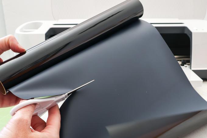 Cutting black vinyl.