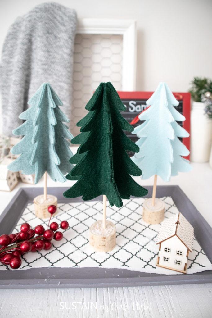 DIY felt 3D Christmas tree decor placed on decorative tray.