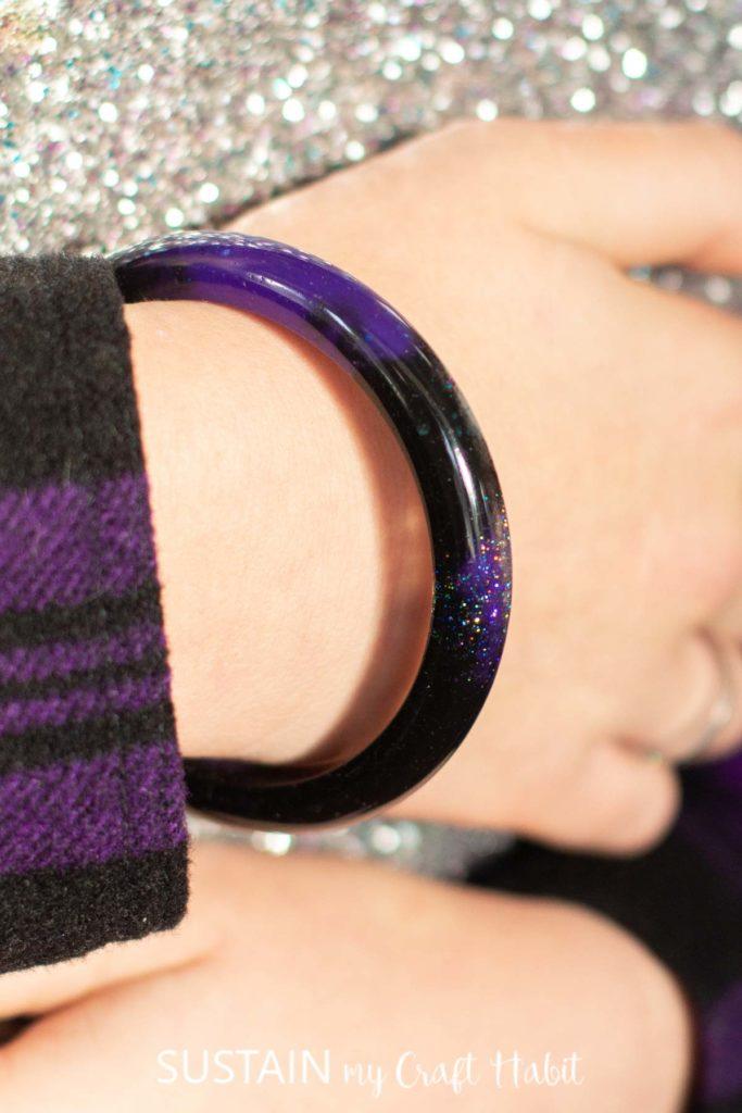 Wearing a galaxy resin bracelet.