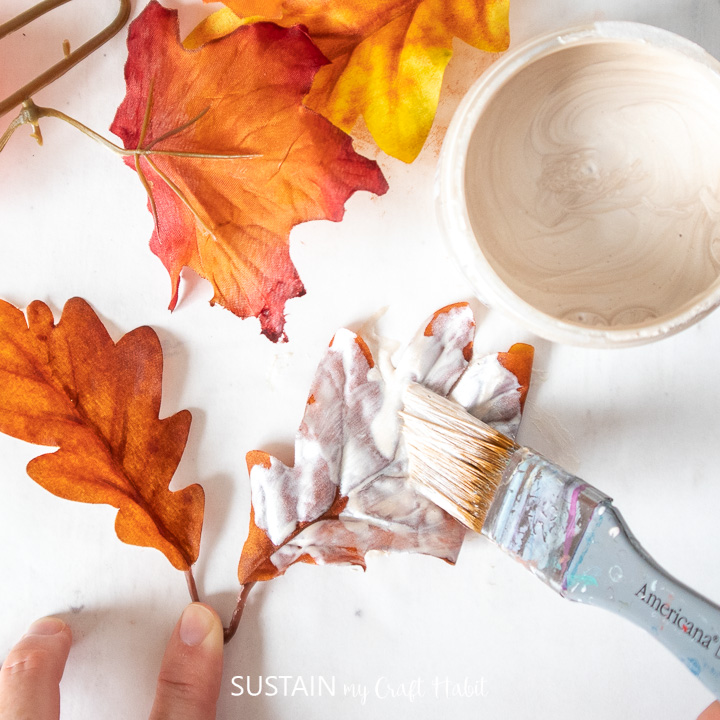 Painting a faux leaf with Ivory Pearl Metallic paint.