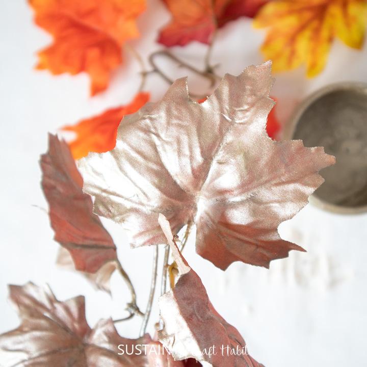 Painted faux maple leaf.