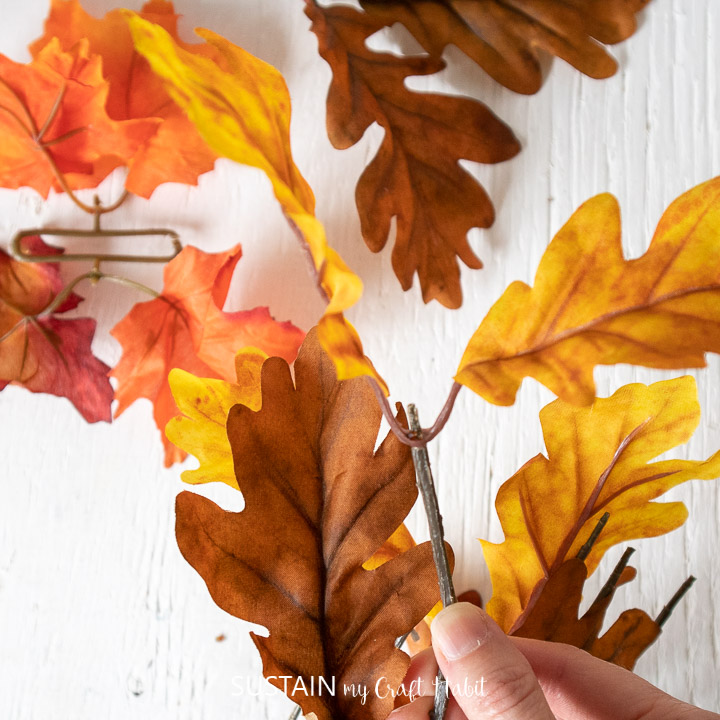 Seperating faux fall leaves.