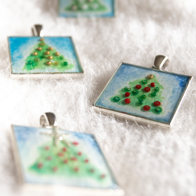 Close up of the finished Christmas tree resin pendants.