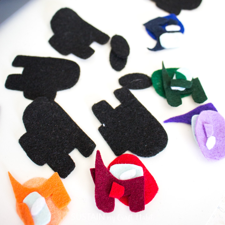 all of the felt pieces cut out for making Among Us pencil toppers