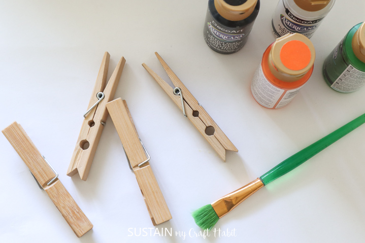 Gathering the supplies needed to make clothespin crafts for Halloween.