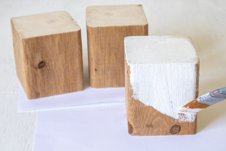 Painting a wood block white.