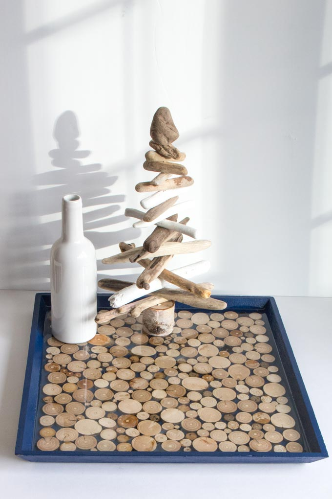Resin tray with driftwood holding decor.