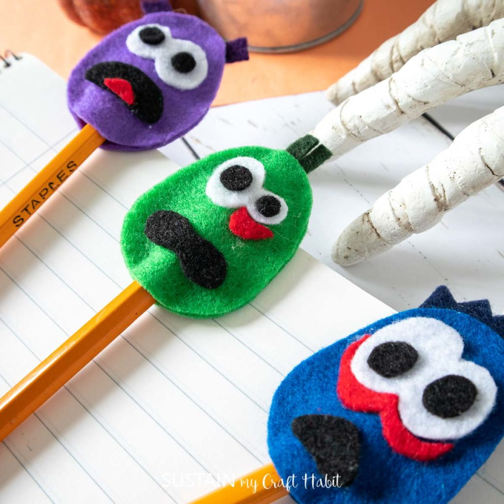 completed green, blue and purple felt DIY monster pencil toppers