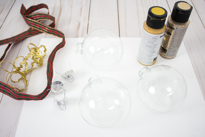 Removing the caps from the glass ornaments.