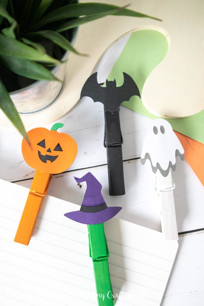 Painted clothespins with Halloween images on top.