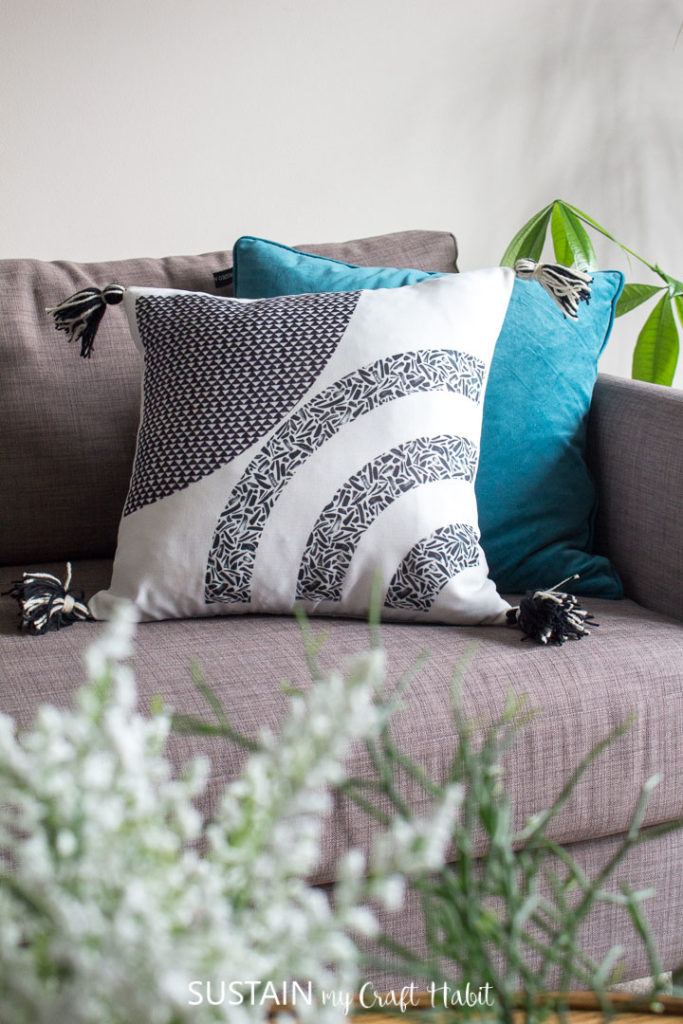 Throw pillows with tassels places on a couch.