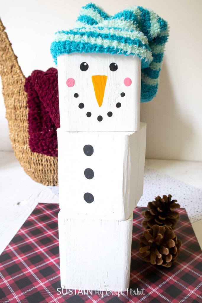 Painted wood blocks stacked to make a snowman.