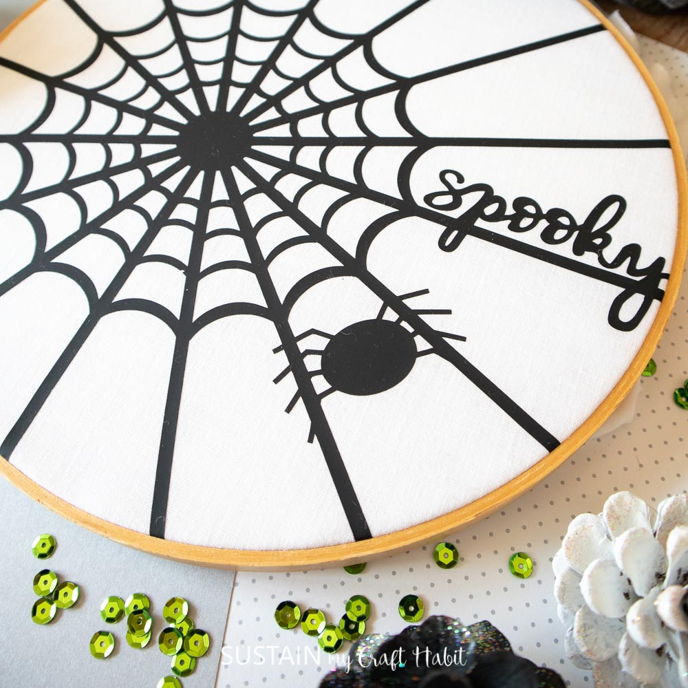 completed spider web art inside an embroidery hoop