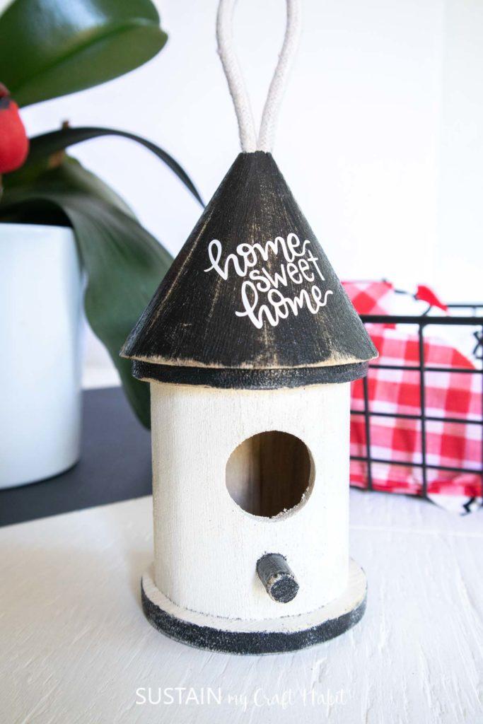 Rustic wooden birdhouse craft ornament.